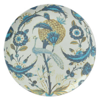 Iznik dish painted with a peacock perched among fl