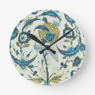 Iznik dish painted with a peacock perched among fl wall clocks