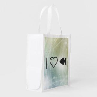 Izquierdas frescas de los pescados bolsas de la compra
