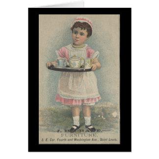 J.H. Chica joven de los muebles de la grúa con la Tarjeton