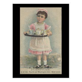 J.H. Chica joven de los muebles de la grúa con la Postal