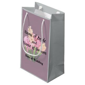 Jacintos anaranjados y rosados que casan productos bolsa de regalo pequeña