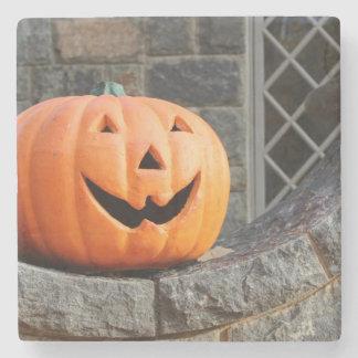 Jack-o-lantern on a stone wall stone coaster