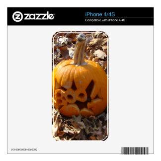 Jack o lantern pumpkin in leaves iPhone 4 skin
