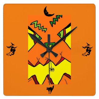 Jack-O-Linterna de Halloween y reloj de la araña