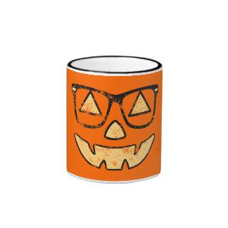 Jack-O-Linterna del vintage con la taza de