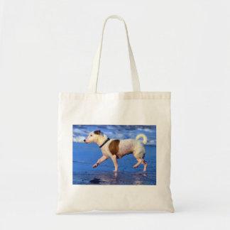 Jack Russell Terrier que corre en la playa Bolsas Lienzo