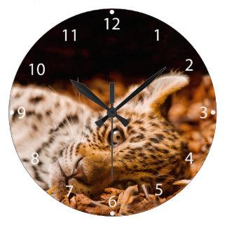 Jaguar Cub Lying in Foliage Large Clock