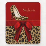 """Jaguar Stilettos Custom Mouse Pad<br><div class=""""desc"""">Stylish mouse pad with graphics of a brown and black jaguar pattern, on the bottom half of the mouse pad and a solid red background, on the top. A red satin looking ribbon and bow, runs across the middle of the pad and fashionable jaguar print stiletto heels decorate the top....</div>"""