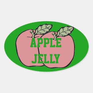 Jalea de Apple roja de dos manzanas en una Pegatina Ovalada