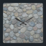 """Jamaica Stones Pebbles Rocks Texture Pattern Photo Square Wall Clock<br><div class=""""desc"""">Stones Pebbles Rocks Nature Pattern Photo Wall Clock. Features a photograph from a stone walkway by the Caribbean Sea in Negril, Jamaica. It has a muted gray tone to it. A fun unique stone pattern for your wall clock. Available in your choice of product shape, round or square, and size....</div>"""