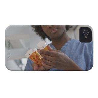 Jamaican female nurse checking pill bottles iPhone 4 Case-Mate case