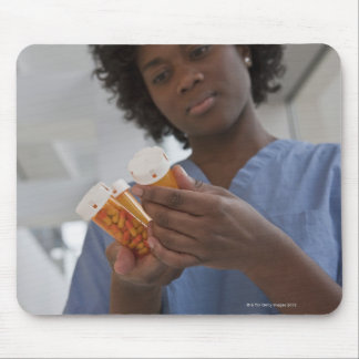 Jamaican female nurse checking pill bottles mouse pad