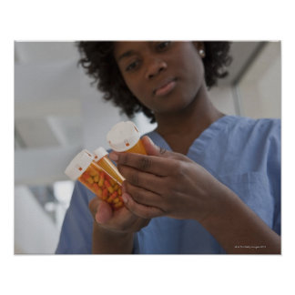 Jamaican female nurse checking pill bottles poster
