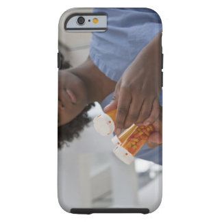 Jamaican female nurse checking pill bottles tough iPhone 6 case