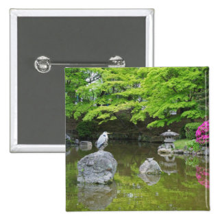 Japan, Kyoto. Heron in fresh green leaves Button