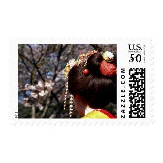 Japan, Kyoto. Rear view close-up of geisha's Postage