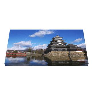 Japanese Castle surrounded by blue castle moat Canvas Print