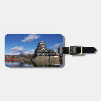 Japanese Castle surrounded by blue castle moat Travel Bag Tags