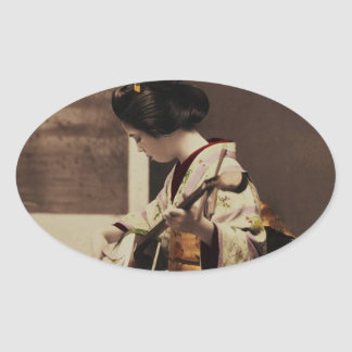 Japanese geisha playing the shamisen oval sticker