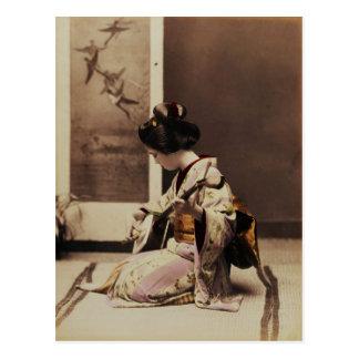 Japanese geisha playing the shamisen postcard
