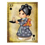 Japanese girl in kimono serving tea postcard