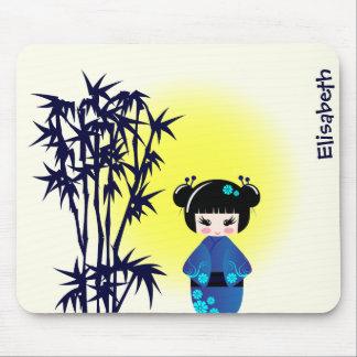 Japanese kokeshi doll at bamboo during sunrise mouse pad