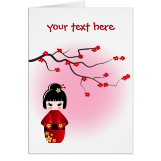 Japanese kokeshi doll at sakura blossoms card