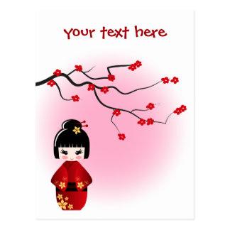 Japanese kokeshi doll at sakura blossoms postcard