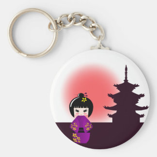 Japanese kokeshi doll at temple during sunset keychain