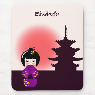 Japanese kokeshi doll at temple during sunset mouse pad