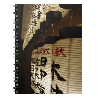 Japanese lanterns at night spiral note book
