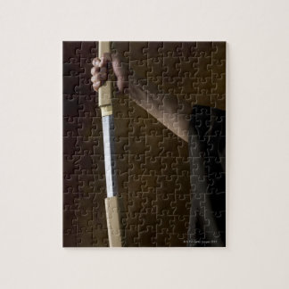 Japanese man holding sword 2 jigsaw puzzle