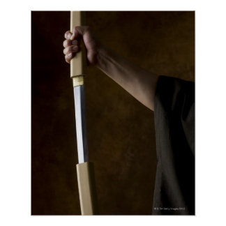 Japanese man holding sword 2 posters