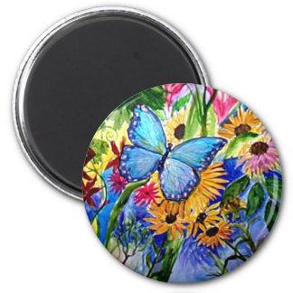 Jardín azul de la mariposa imán de frigorifico