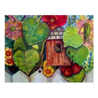 Jardín de la cabaña de la casa del pájaro postal