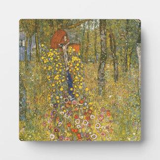 Jardín de la granja de Klimt con la placa del cruc