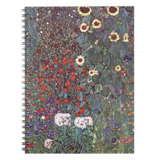Jardín del país con los girasoles cuadernos