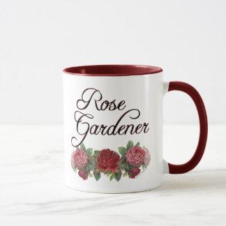 Jardinero color de rosa que dice con los rosas taza