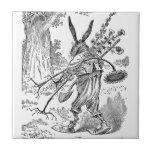 Jardinero del conejo con la pala y las plantas des azulejo ceramica