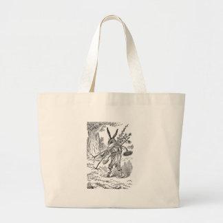 Jardinero del conejo con la pala y las plantas des bolsa de mano
