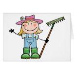 Jardinero rubio ligero con el gorra rosado tarjetas
