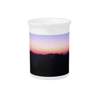 jarra púrpura azul anaranjada de la puesta del sol