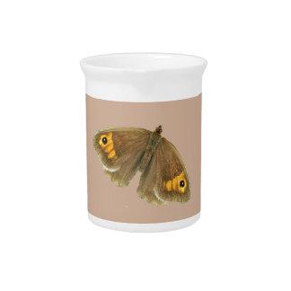 Jarras marrones del diseño de la mariposa del