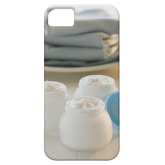 Jars of moisturizing creams and stack of towels iPhone SE/5/5s case