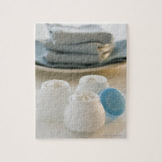 Jars of moisturizing creams and stack of towels jigsaw puzzle