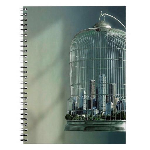 Jaula de pájaros abstracta de la ciudad spiral notebooks