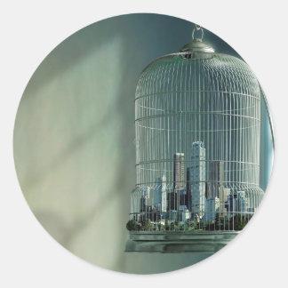 Jaula de pájaros abstracta de la ciudad pegatina redonda