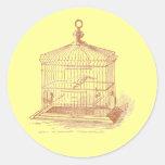 Jaula de pájaros del vintage etiqueta redonda