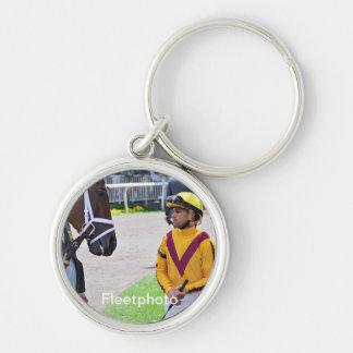 Javier Castellano & Elena's Strike Silver-Colored Round Keychain